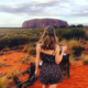 Jess standing in front of Ayers Rock admiring the view