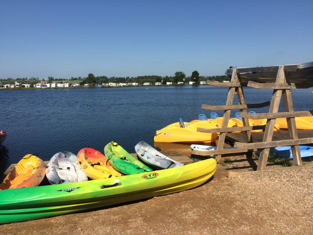 Kayaks and watersports equipment on the lake