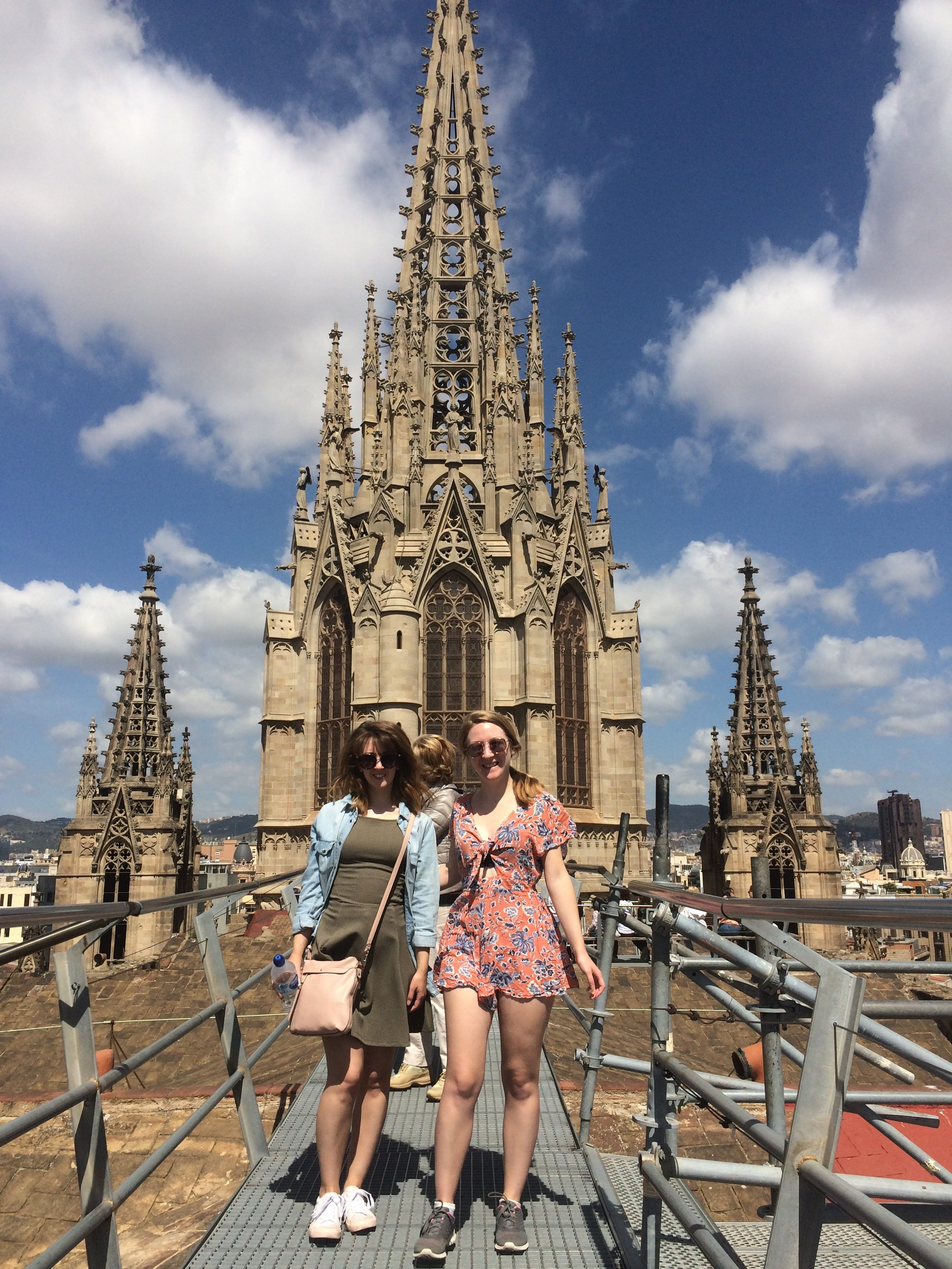 me and my sister on the roof of catedral de barcelona